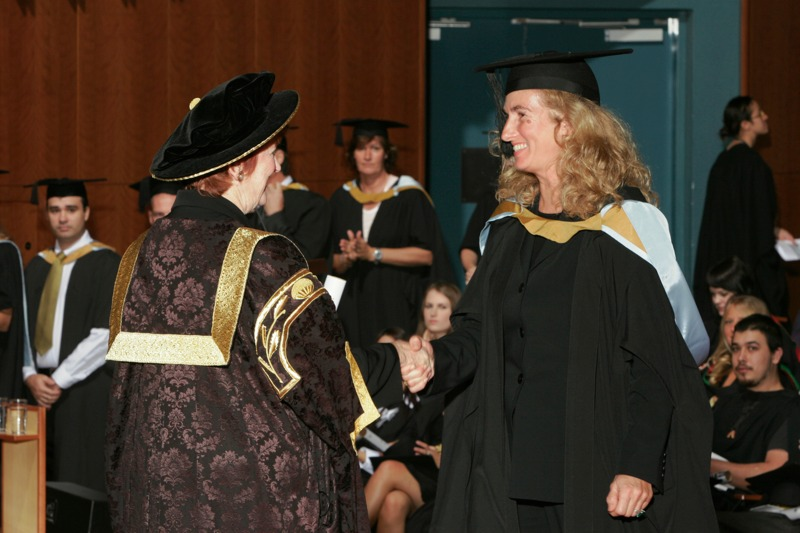 Annita Keating receiving her degree from Pro-Chancellor, The Honourable Susan Ryan, AO.